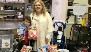 8 Year Old Vito Scarafile collects pet food